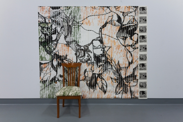 Interior Landscape II (2017) mixed media: charcoal drawings, screen print and collaged linocut prints on wallpaper with printed calico chair cover.